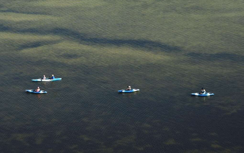Kayakers in a huge expanse of water on the Great Calusa Paddling Trail