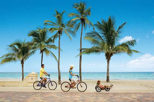 Only swaying palms separate the sands of Hollywood Beach from its 2.5-mile Broadwalk, a retro-cool, car-free fun zone for all.