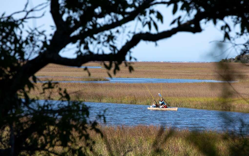 A fisherman kayaks along Simpson Creek in Little Talbot Island, east of Jacksonville.
