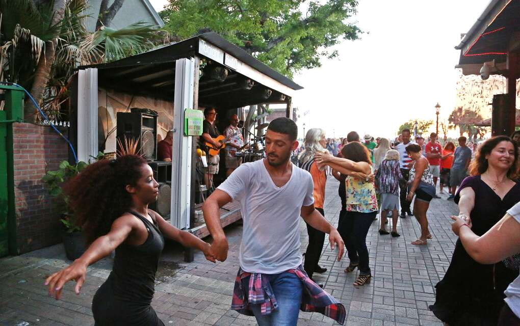 Dancers move to a Latin beat outside of El Meson De Pepe Restaurant and Bar at Mallory Square in Key West.