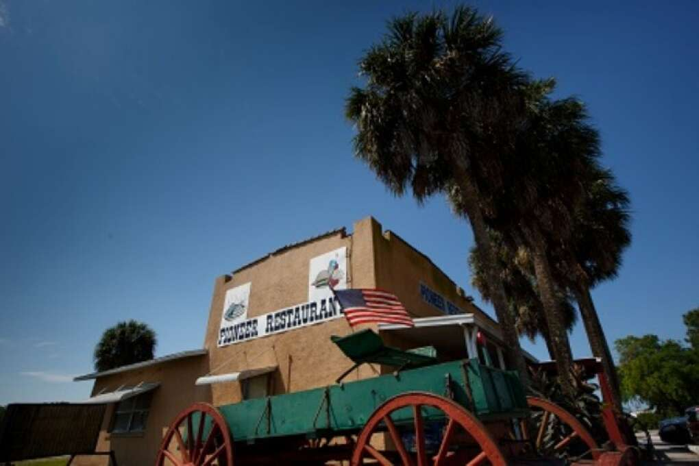 Palm Trees and wagons sit next to the Pioneer Restaurant in Zolfo Springs, Florida on March 2, 2015. VISIT FLORIDA/Scott Audette