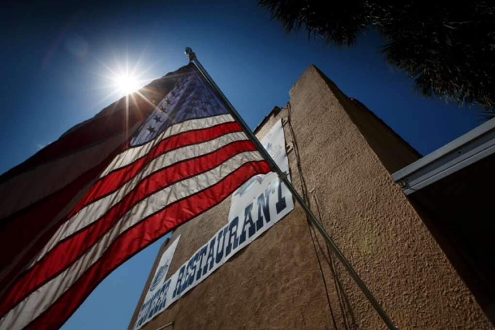 An American flag floats in the breeze outside the Pioneer Restaurant in Zolfo Springs, Florida on March 2, 2015. VISIT FLORIDA/Scott Audette