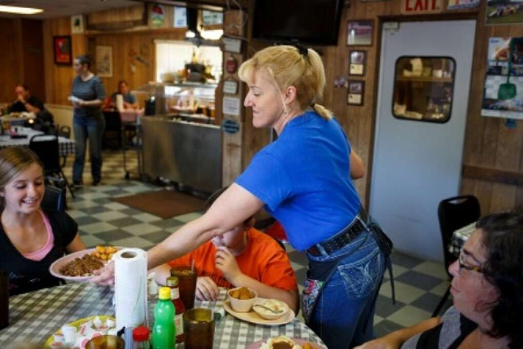 A waitress serves a group pf diners some of the Pioneer Restaurant's homestyle meals in Zolfo Springs, Florida on March 2, 2015. VISIT FLORIDA/Scott Audette