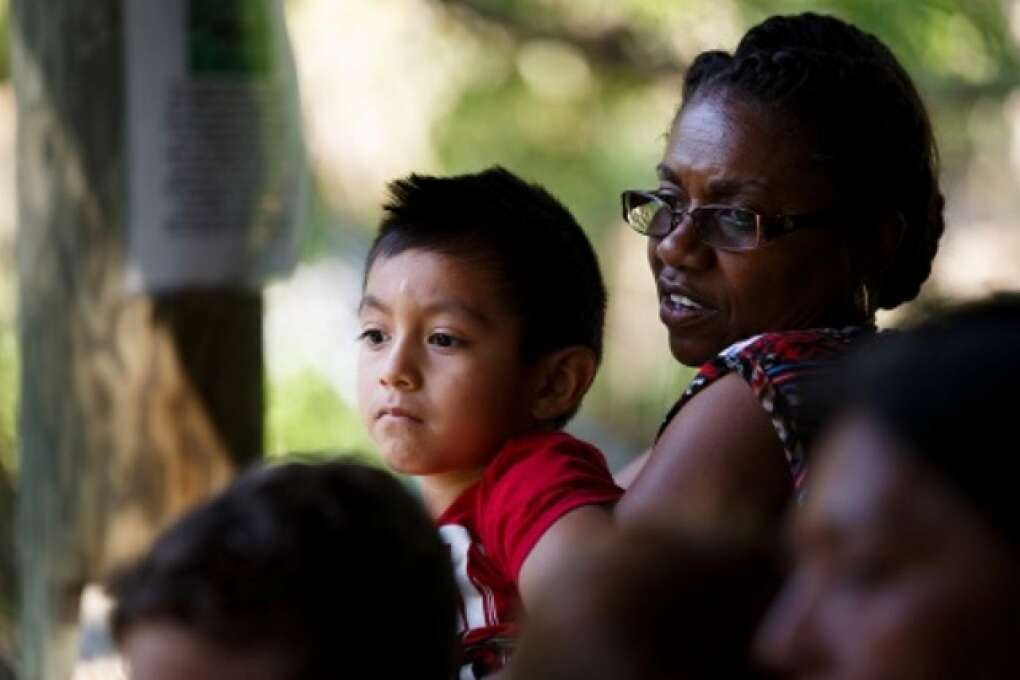 A local pre-schooler assisted by a teacher looks out over the cougar pen at Hardee County Wildlife Refuge in Zolfo Springs, Florida on March 2, 2015. VISIT FLORIDA/Scott Audette