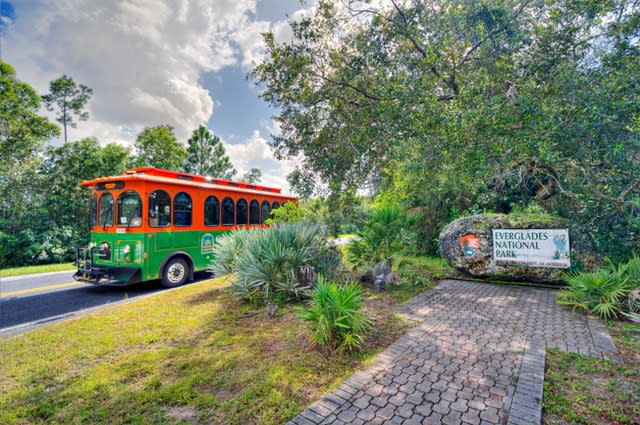 An orange and green Trolley at the Everglades National Park