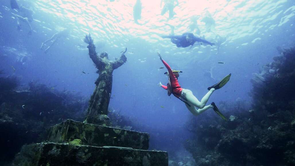 Christ of the Abyss, at John Pennekamp Coral Reef State Park, with snorkelers.