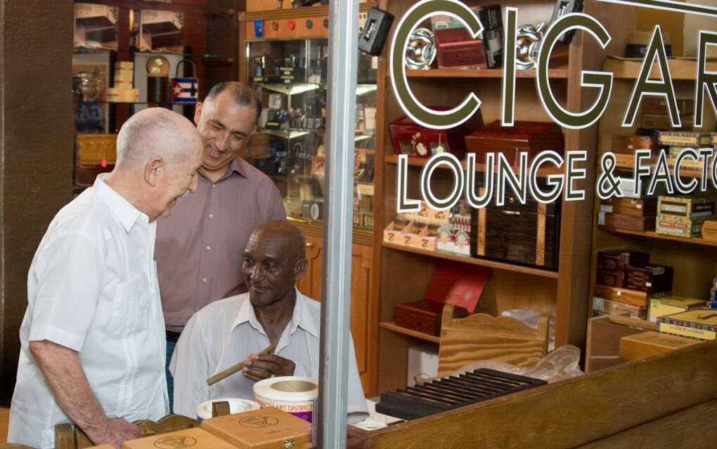 three happy men at cigar shop in Calle Ocho