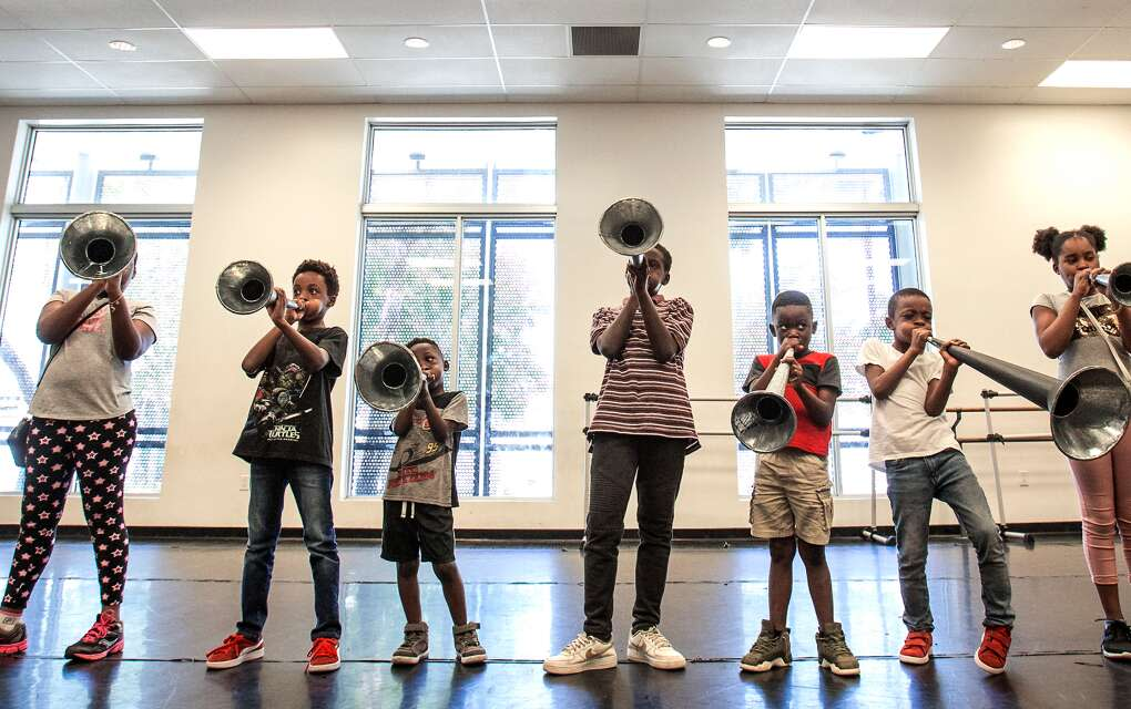 Young campers in the TLL Spring Fest Camp at the Little Haiti Cultural Center learn Haitian rara music on metal