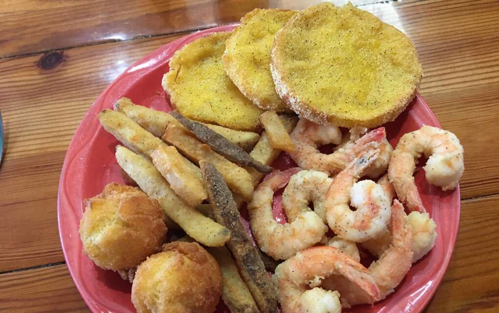 At Lightsey's discover home-cooking like this plate of fried shrimp, hush puppies, fried green tomatoes, and french fries.