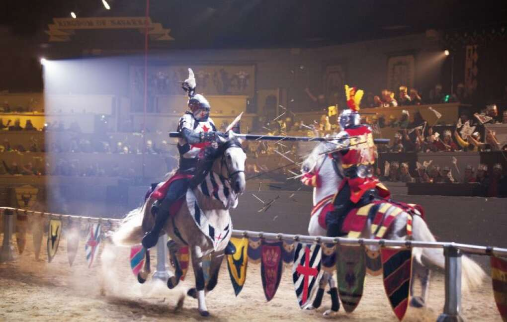 """Dinner and a show at the Medieval Times Dinner & Tournament inside a """"castle"""" includes knights jousting, swordplay and horsemanship."""