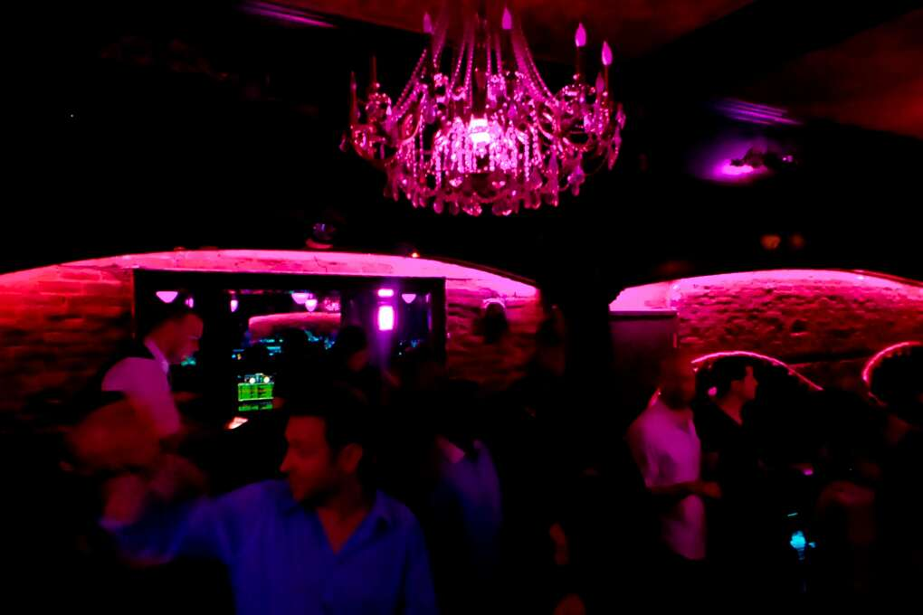 People socializing and dancing at an Orlando nightclub