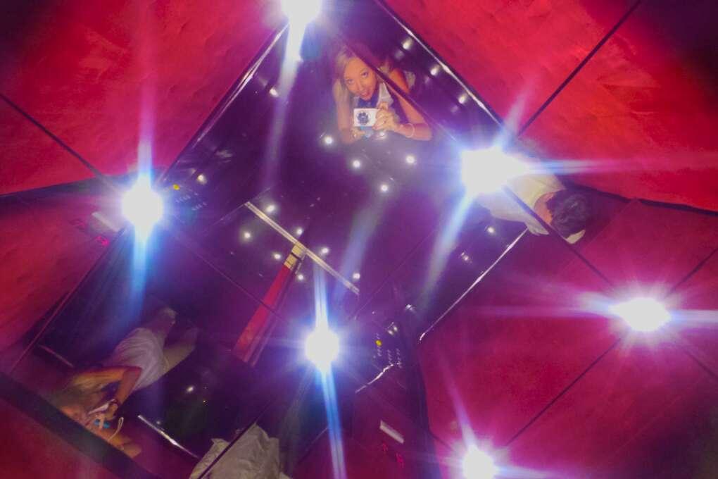 People taking selfies in Grand Bohemian elevator mirrored ceiling