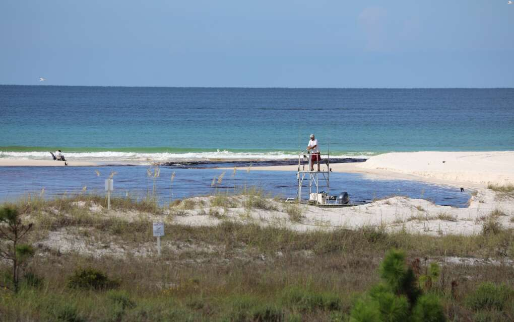 Person on fishing boat fishing at Camp Helen State Park in Panama City Beach