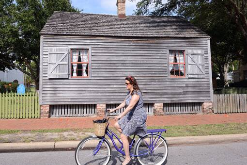 A woman cruises past the Julee Cottage Museum to discover new Pensacola History