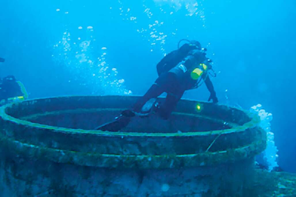 A diver swims at the U.S.S. Oriskany reef dive site