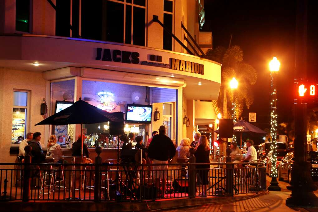 The Saturday night crowd enjoys sidewalk music at Jacks On Marion in downtown Punta Gorda after dark. The area is home to several restaurants, bars, and hotels near the Peace River.