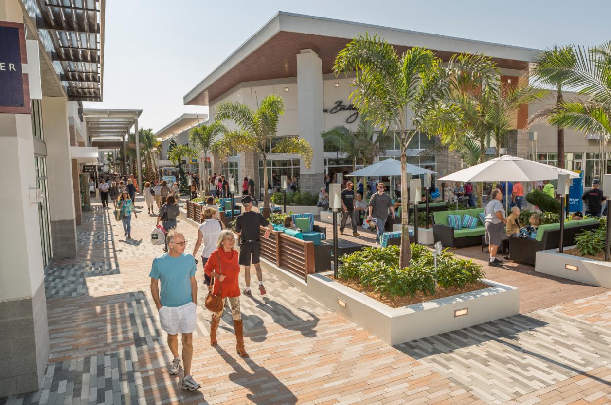 Shoppers at Tanger Outlets in Daytona Beach near the Daytona International Speedway