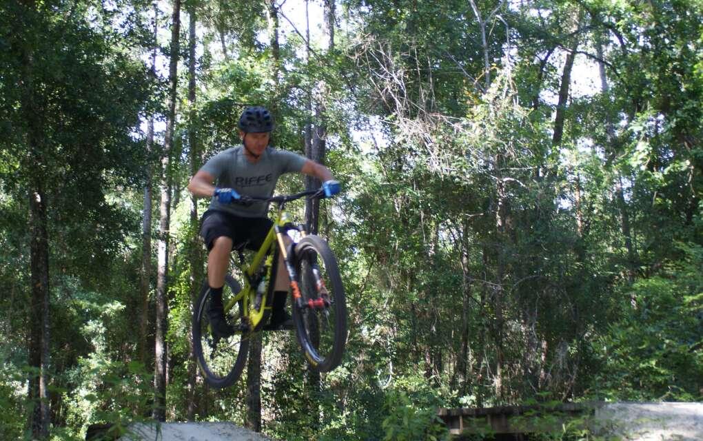 mountian biker navigates the pit at Santos Trailhead