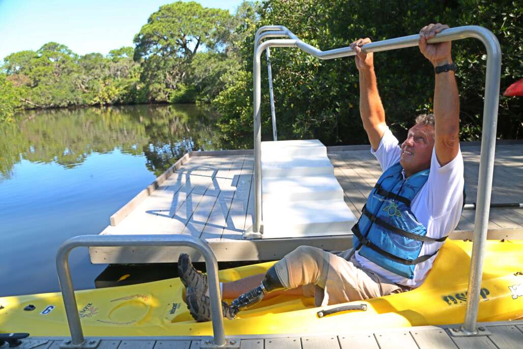 . Rod Thomas of Osprey uses a kayak launch made for disabled visitors so they may launch their kayaks at Oscar Scherer State Park.