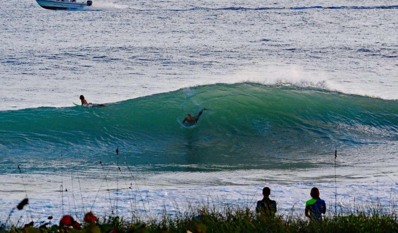 surfers at Sebastian Inlet State Park, near Melbourne, Fla.
