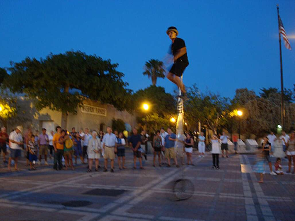 People watching a man in a monocycle at Mallory Square in Key West