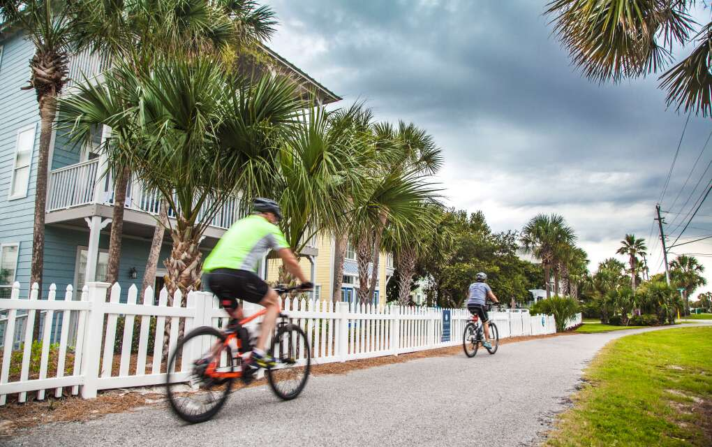 bikers on trail in front of cute houses in Destin