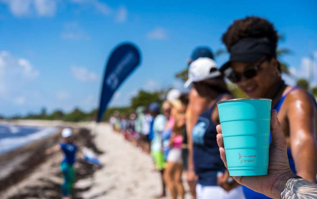 Pirani cup being held in the hand of a beachgoer in Fort Lauderdale