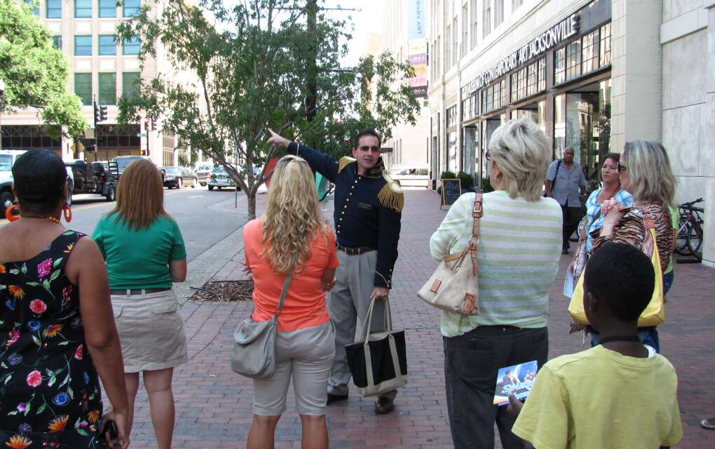 An Ad Lib Tour guide takes visitors past the historic downtown Jacksonville library on a walking tour of Jacksonville.