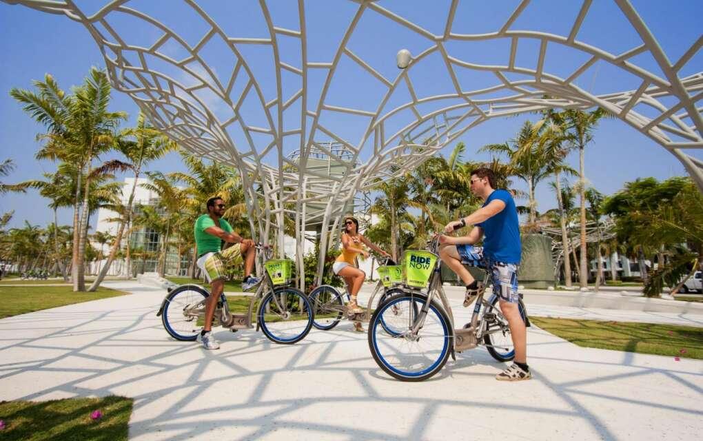 Citi Bike Miami, bikers under cool structure