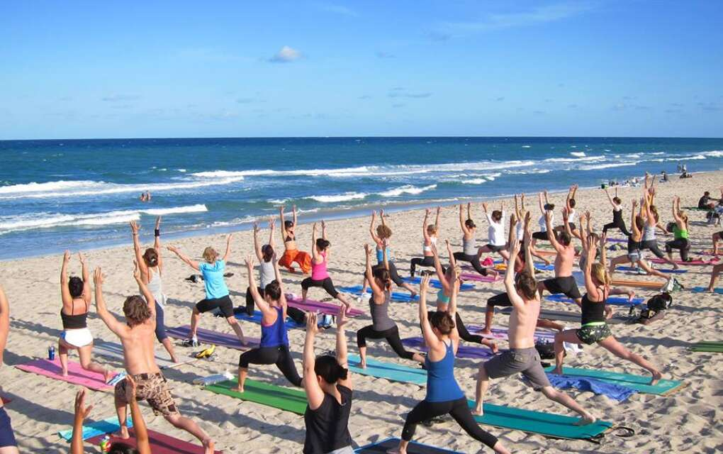 Sunset yoga class, Delray Beach, people on beach in yoga poses
