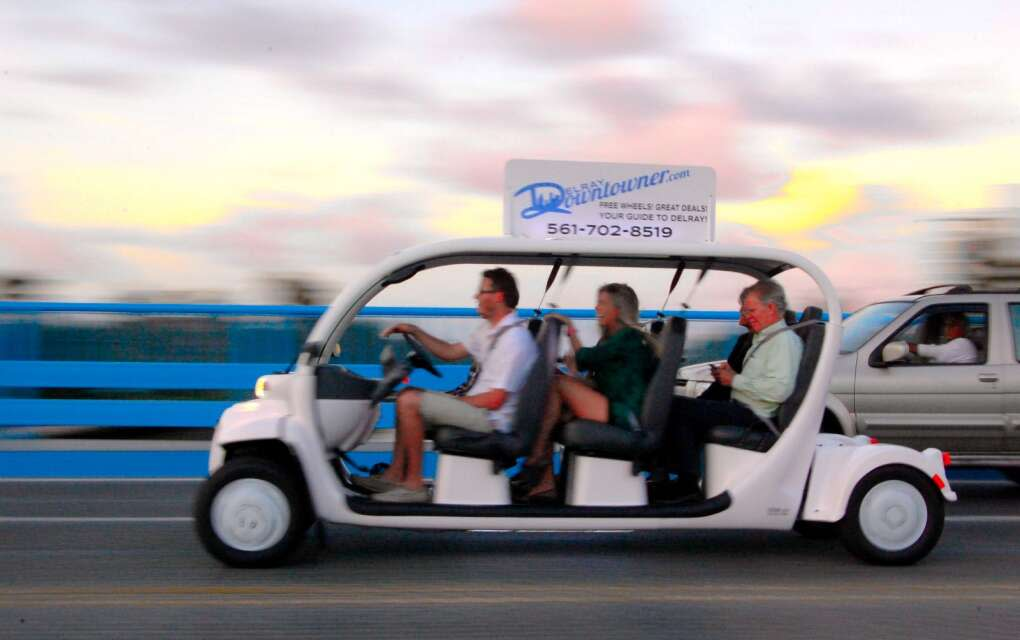 The Delray Downtowner Golf Cart Service, people enjoying free ride