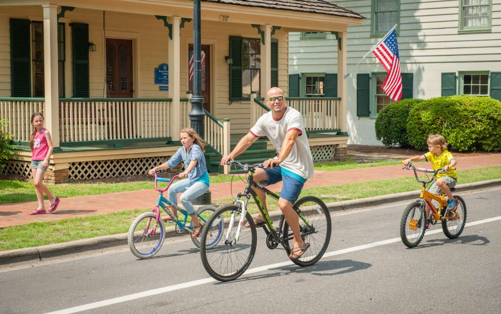 family biking down Pensacola street