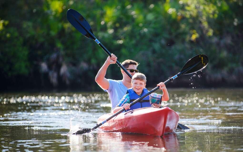 boy and man paddling in Sarasota waters
