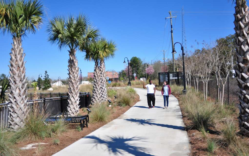people walking on Tallahassee's Cascades Park Trail
