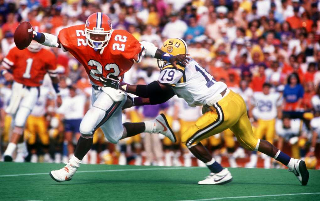 Emmitt Smith playing American football with the University of Florida Gators team