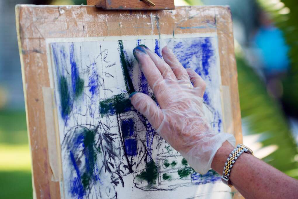Painters using pastels for fun artistic activities in Florida