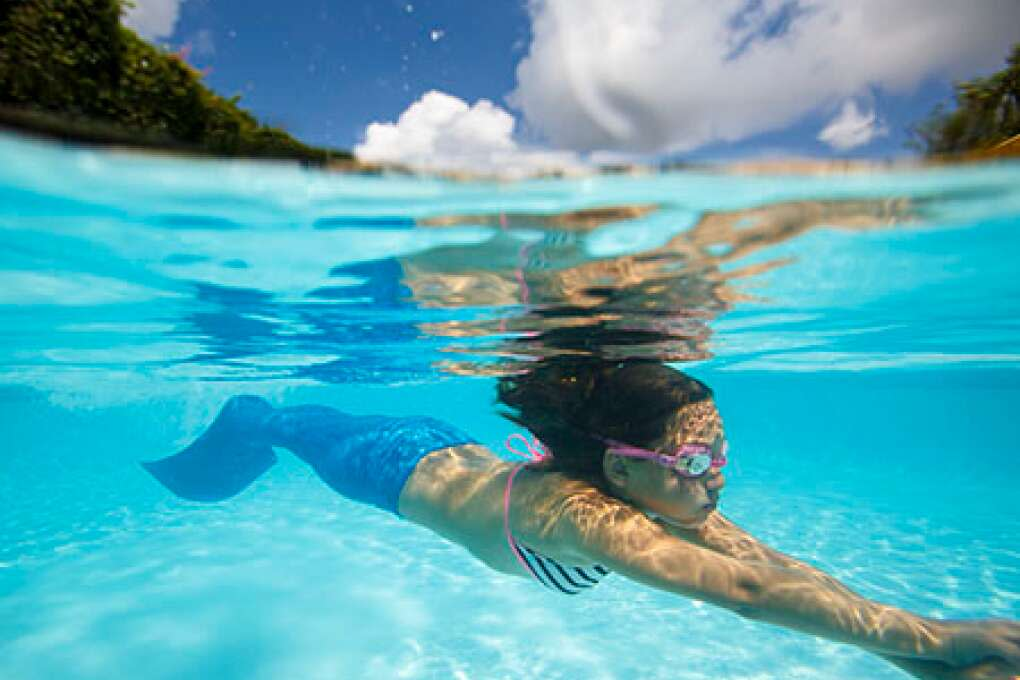 Gianna Horne, 8, dives using her monofin during The Mermaid Academy at the Hyatt Regency Grand Cypress.