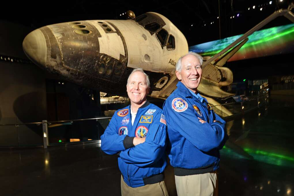 After the main multi-media show you actually get to meet real astronauts who flew missions on Space Shuttle Atlantis, at the Kennedy Space Center Visitors Complex. Thomas D. Jones, PhD, left and Robert C. Springer (Colonel, USMC, Ret) both flew missions on Atlantis.