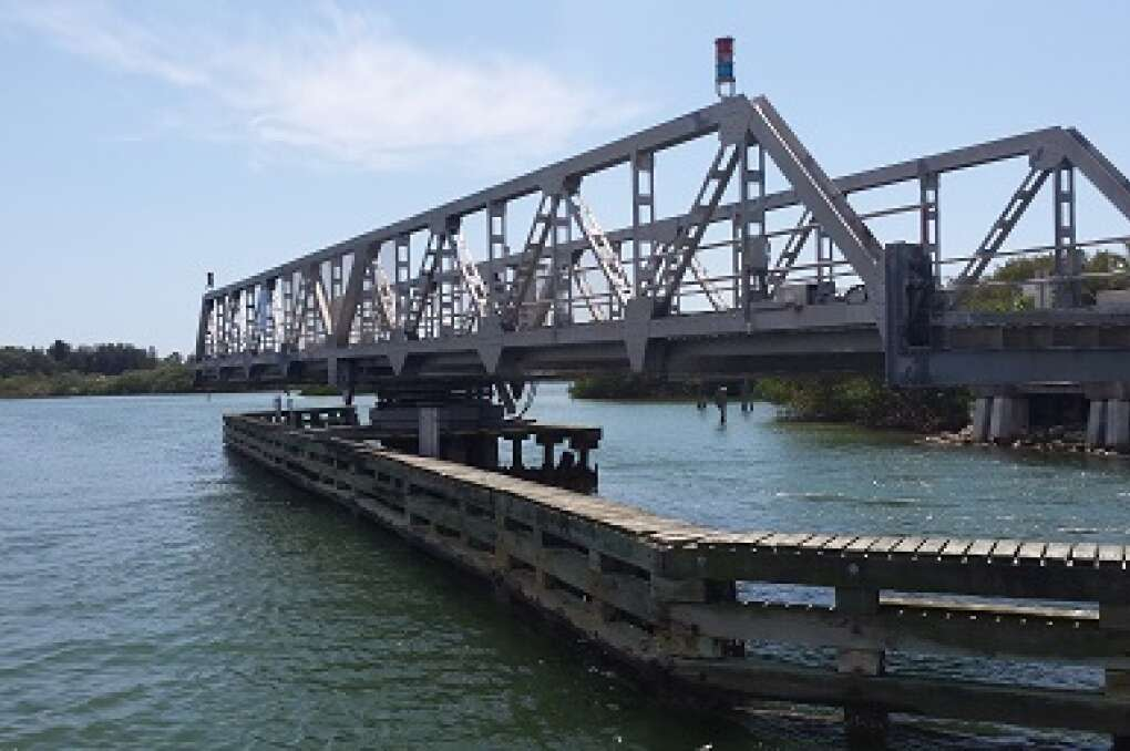 At Blackburn Point, where the Intracoastal is so narrow kids could toss footballs across, a swing bridge opens for boat traffic.