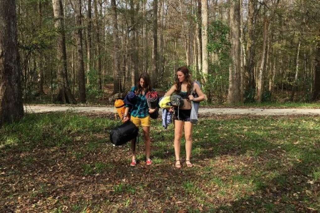 two girls holding camping gears at Ginnie Springs camping area