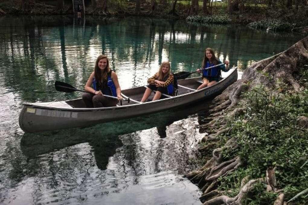 three girls canoeing at Ginnie Springs