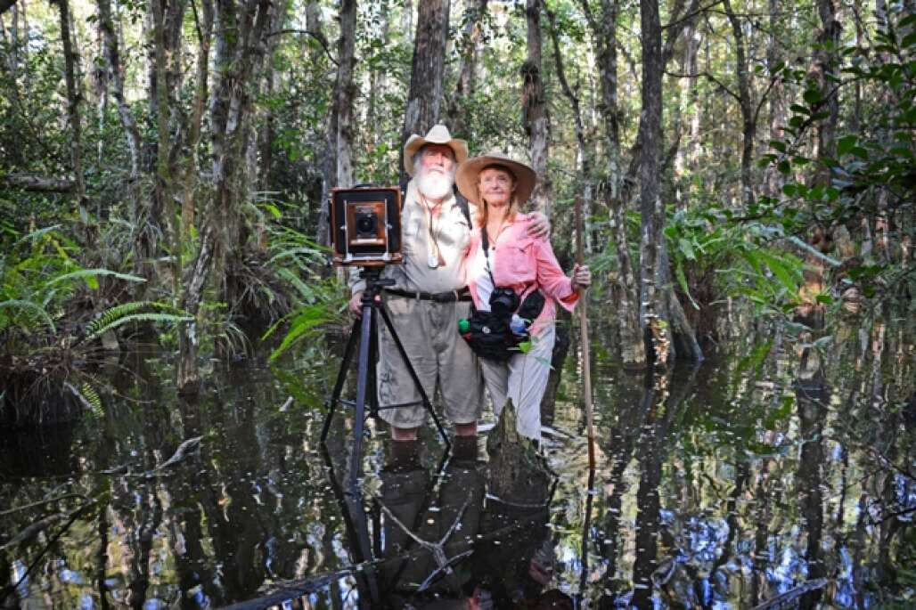 couple standing in the middle of the corkscrew swamp