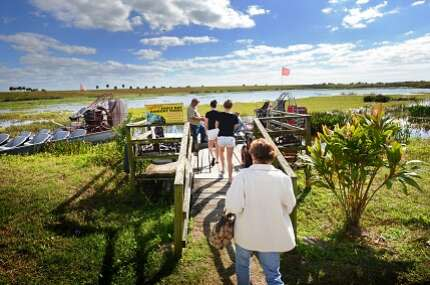 Tourists arrive at Eagle Bay Airboat Rides on State Road 78, just south of of Okeechobee and just down the road from Lightsey's Seafood Restaurant.
