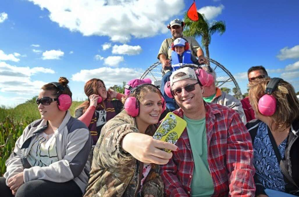 Leaving the docks at Eagle Bay Airboat Rides, Aimee Nunn makes a selfie with her dad, Bobby