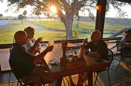 Enjoy a cool drink at sunset on the porch of Lightsey's Seafood restaurant near Okeechobee.