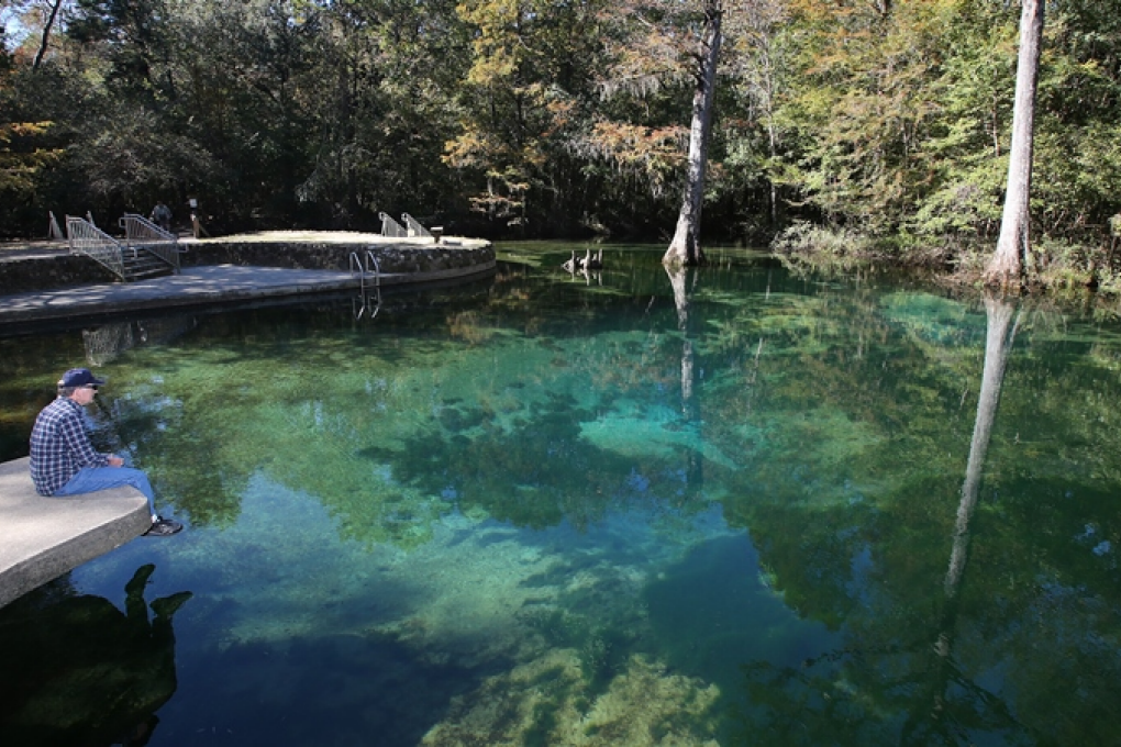 A visitor enjoys a quiet morning at Ponce de Leon Springs.