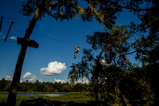 A breathtaking view and lots of personal physical challenges await guests at TreeHoppers Aerial Adventure Park in Dade City.