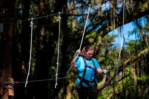 Jessica Cook of Tampa Bay Moms Blog (http://tampabay.citymomsblog.com) works her way through an element at the TreeHoppers Aerial Adventure Park on September 20, 2015 in Dade City. VISIT FLORIDA/Scott Audette