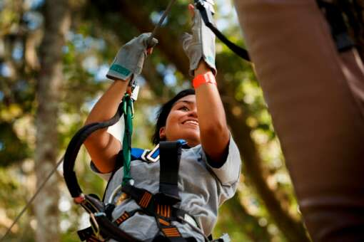A young guest reaches the next platform after zipping thru the forest canopy at TreeHoppers Aerial Adventure Park on September 20, 2015 in Dade City. VISIT FLORIDA/Scott Audette