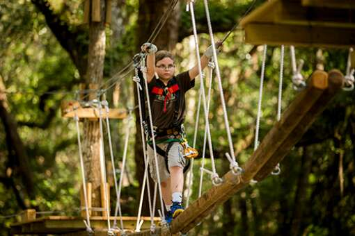 TreeHoppers Aerial Adventure Park presents a variety of physical challenges from walking between trees on a system of ropes and boards and pulleys to ziplining between platforms.